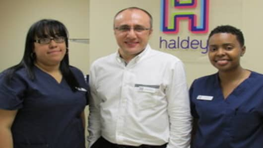 Dr. Emil Haldey with associates