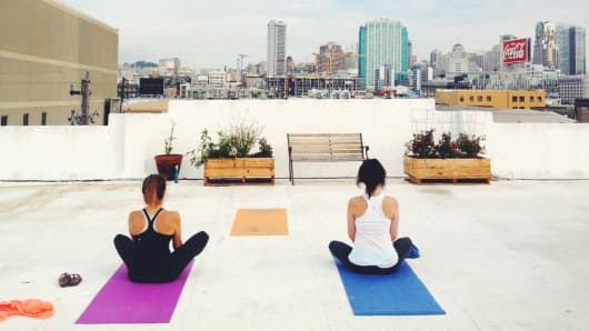 OpenDNS employees take Yoga lessons on their company rooftop.