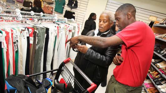 Customers shop at a T.J. Maxx store in Washington.