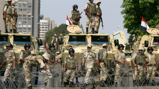 Egyptian army soldiers block Salah Salem highway to prevent supporters of the Muslim Brotherhood and ousted Egyptian president Mohamed Morsi from crossing during their demonstration in Cairo.