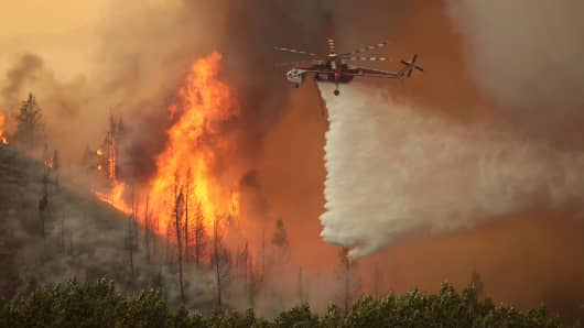 Helicopters battle the 64,000 acre Beaver Creek Fire on Friday, Aug., 16, 2013 north of Hailey, Idaho.