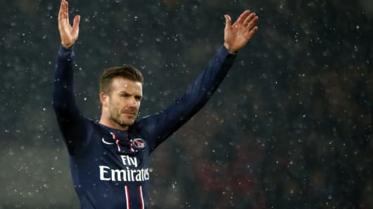 new product 52f7a a0ae2 French soccer team PSG scores on shirt sales with Beckham