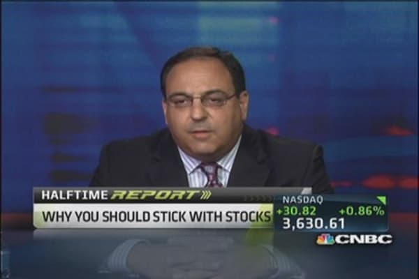 Stick with stocks through the taper: Strategist