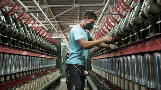uses a machine to produce jute twine at Brasjuta da Amazonia S.A. in Manaus, Brazil, June 28, 2013.