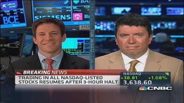 Nasdaq OMX down as trading resumes