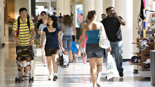 Shoppers walk through Roosevelt Field Mall in Garden City, New York.