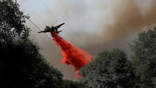An air tanker drops fire retardant on a ridge ahead of the advancing Rim Fire on August 22, 2013 in Groveland, California.