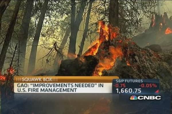 Wildfires sweep western US
