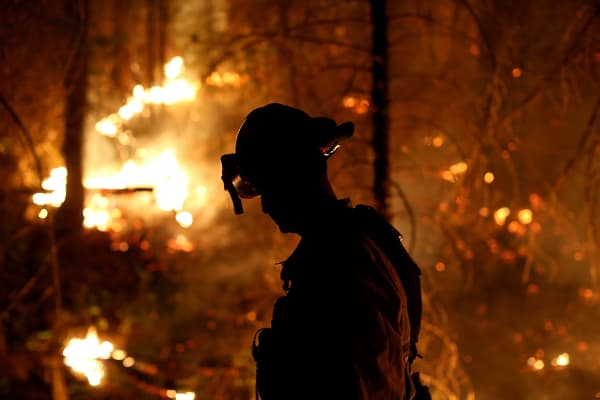 A firefighter from Cosumnes Fire Department monitors a back fire while battling the Rim Fire on August 22, 2013 in Groveland, California.