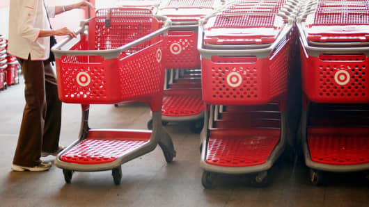 Customers reach for shopping carts inside the Target Corp. Store in Torrance, California.