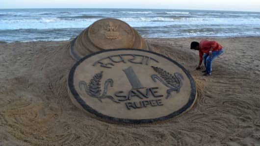 Indian artists call for help to save the sliding rupee.