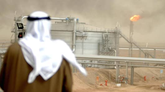 An employee of the Kuwait Oil Company (KOC) looks at the Gathering Center No.15 of al-Rawdatain field, 100 kms north of Kuwait City.