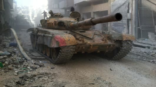 A Syrian government forces' tank rolls in the Khaldiyeh district of Syria's central city of Homs.