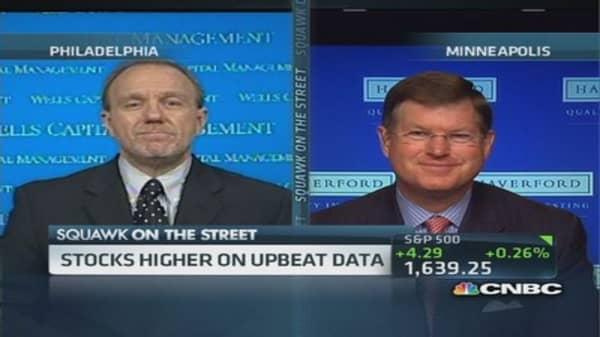 Stocks edge higher on upbeat data