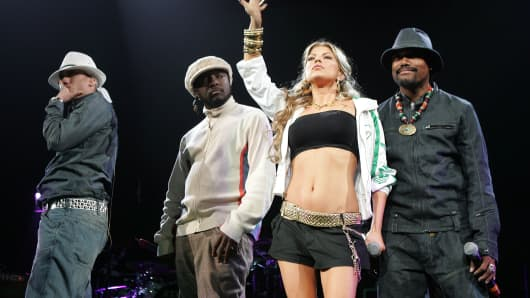 (From left to right) Taboo, Will.I.Am, Fergie, and Apl.de.Ap of the Black Eyed Peas perform in New Jersey in 2005.