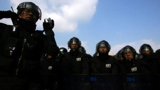 Riot police line up at an anti Free Trade Agreement rally in Seoul, South Korea.