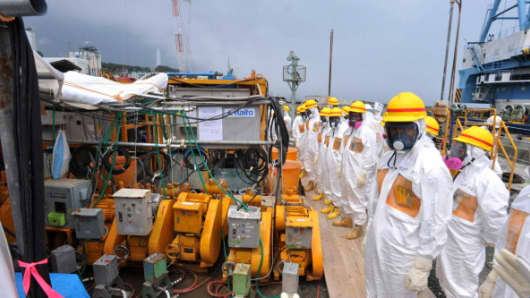 Government officials and nuclear experts inspect a facility to prevent seeping of contamination water into the sea at TEPCO's Fukushima Dai-ichi nuclear plant.