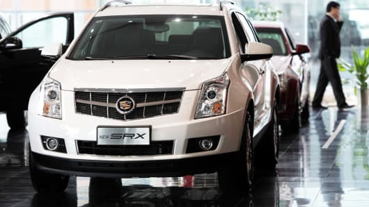 A Cadillac SRX SUV displayed at a dealership in Shanghai