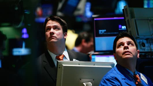 Traders on the floor of the NYSE on December 1, 2008.