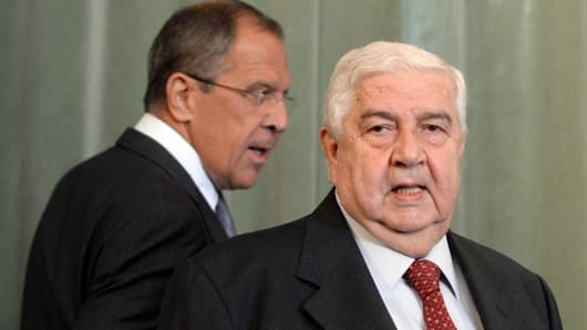 yrian Foreign Minister Walid Muallem (R) and and his Russian counterpart Sergei Lavrov (L) walk to a press conference on September 9, 2013 following a meeting in Moscow.