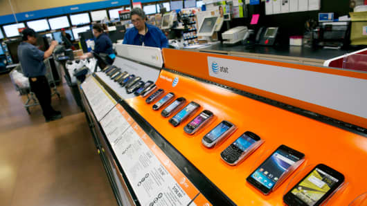 Various smartphone devices are displayed for sale at a Wal-Mart Stores Inc. location in American Canyon, California.