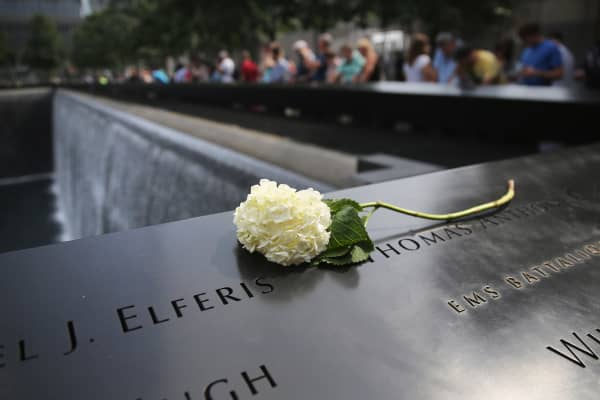 A flower lies atop names of victims at the 9/11 Memorial in New York on Sept. 10