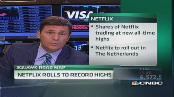 Netflix rolls to record highs