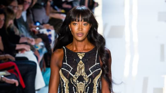 Naomi Campbell walks the runway during the DVF fashion show at MBFW Spring 2014 in New York.