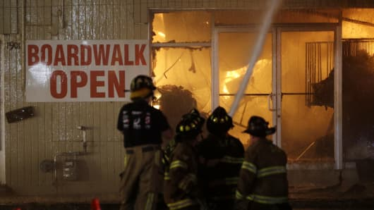 Firefighters battle a blaze in a building on the Seaside Park boardwalk on Thursday, Sept. 12, 2013, in Seaside Park, N.J.