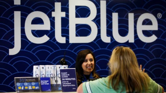 File photo: A Customer Service agent helps a passenger at the check-in counter for JetBlue Airways Corporation at Long Beach Airport (LGB) in Long Beach, California