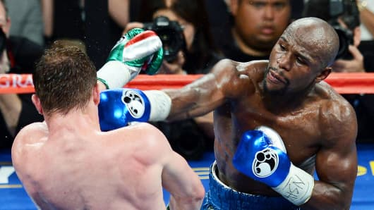 Floyd Mayweather Jr. and Canelo Alvarez in the seventh round of their title fight in Las Vegas on Saturday