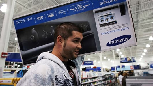 Shoppers move through a Best Buy store in Naples, Florida.