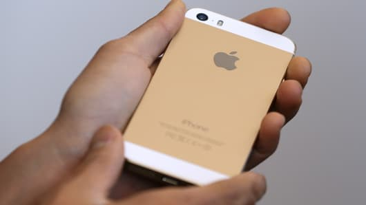 The new iPhone 5S is displayed during an Apple product announcement at the Apple campus in Cupertino, California.