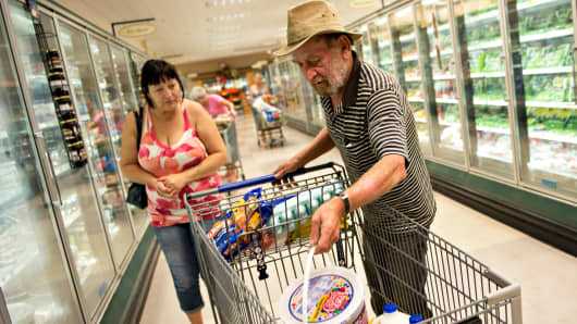 Shoppers at a Kroger supermarket in Peoria, Ill.