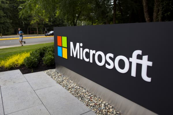 A jogger runs past signage displayed at the Microsoft Corp. campus in Redmond, Washington.