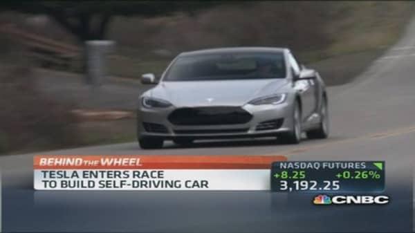 Tesla enters race to build self-driving car