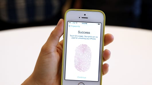 The new iPhone 5S with fingerprint technology is displayed during an Apple product announcement.