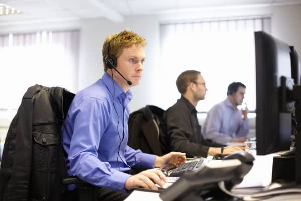 Telemarketers at a call center