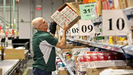 A Peapod worker at one of its online distribution facilities in Lake Zurich, Ill.