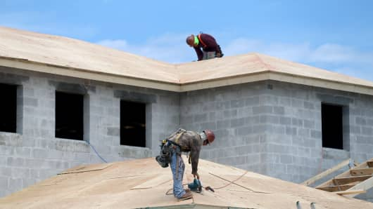 Construction workers build a new home in Homestead, Florida.