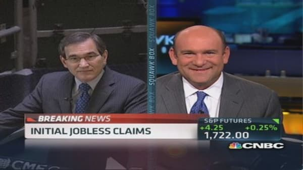 Initial jobless claims up 15,000 to 309,000