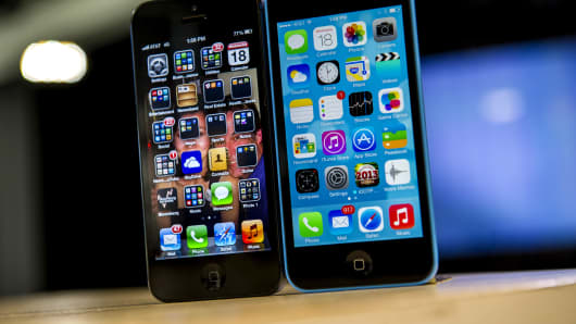 The home screen of an Apple Inc. iPhone 5 operating iOS 6, left, and an iPhone 5C operating iOS 7 is displayed in San Francisco.