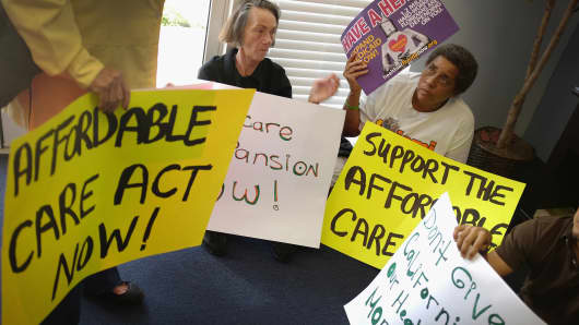 A protest Friday in the Miami office of a Florida state lawmaker against his opposition to expansion of health-care coverage.