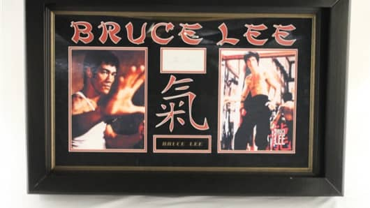 "A double framed and matted ""Bruce Lee"" autographed paper cut from Jesse Jackson Jr.'s collection that was scheduled to be auctioned off to help him repay his debt."