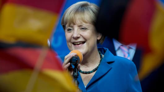 German Chancellor Angela Merkel celebrates at her the Christian Democratic Union (CDU) party's headquarters in Berlin on September 22, 2013, after the German general elections.