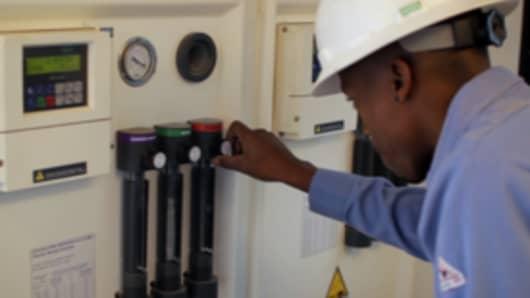 Bosque Technician working on DIONIX Unit