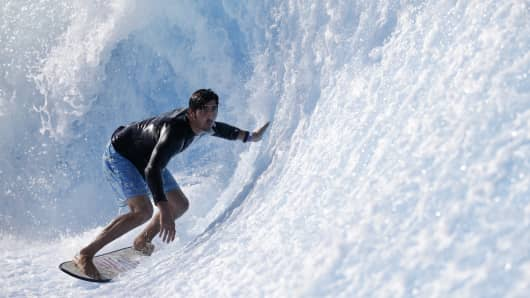 A surfer rides the machine-made wave at Wavehouse in San Diego.