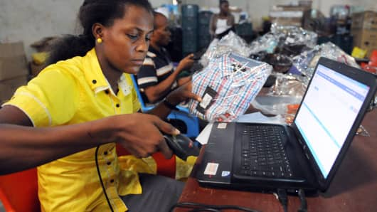 A worker scans a product in Lagos.
