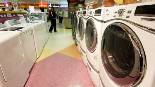 Customers looks at dryers and washing machines at RC Willey appliance store in Orem, Utah.