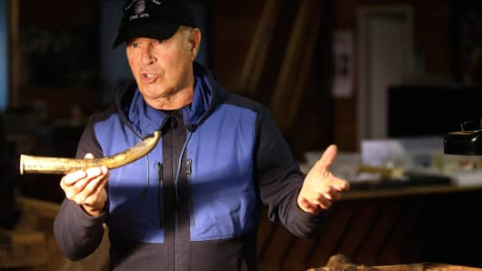 "Underseas explorer Barry Clifford holds the barrel of a partially crushed blunderbuss he salvaged from the wreck of pirate ship ""Whydah"" during an interview in Brewster, Mass., Sept. 17, 2013."
